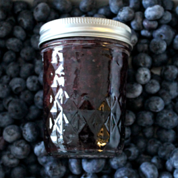 blueberry jam in a bowl of fresh blueberries