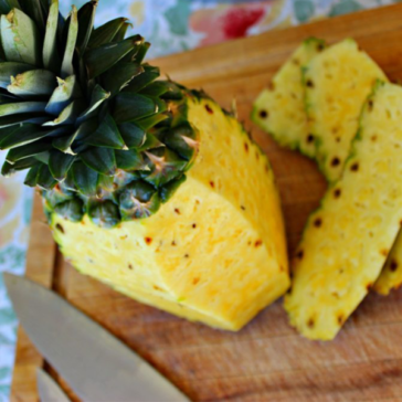 fresh pineapple on a cutting board