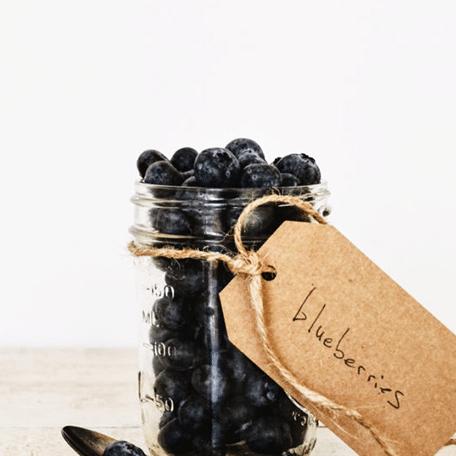 fresh blueberries in a mason jar with craft tag