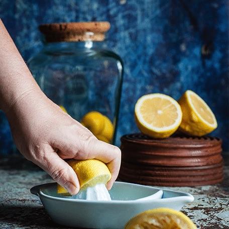 lemon being juiced on a juicer