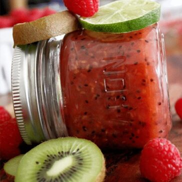 jar of raspberry kiwi lime jam surrounded by ingredients