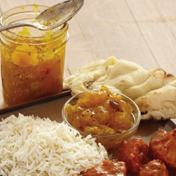 savory spiced mango chutney next to naan, rice and chicken