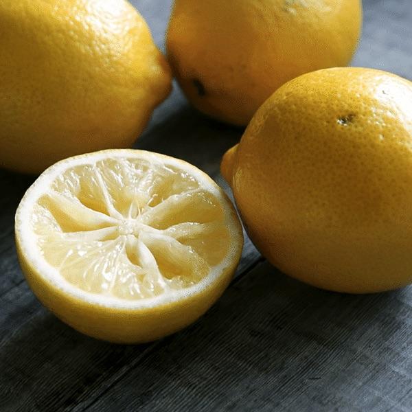 fresh Meyer lemons on a slate table