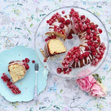 bundt cake covered in glaze and raspberry framboise rose jam