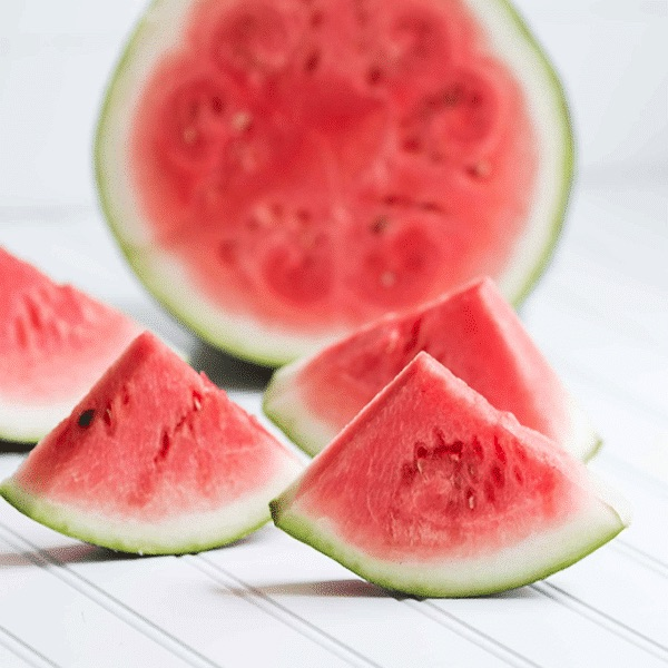 slices of watermelon on a white table