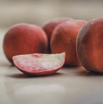 fresh nectarines and a slice of nectarine on a table