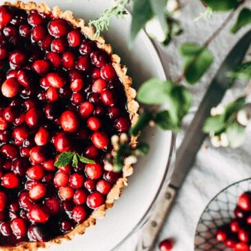 beautiful cranberry tart on a white tablecloth