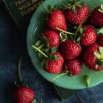 green plate covered in fresh strawberries