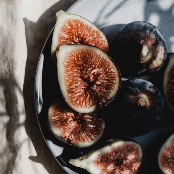 fresh, sliced figs in a bowl in the sun light