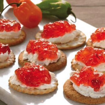 cranberry habanero jelly on top of cream cheese and crackers