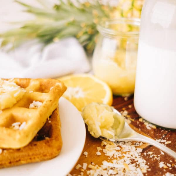 waffle topped with pineapple, lime + coconut jam surrounded by ingredients