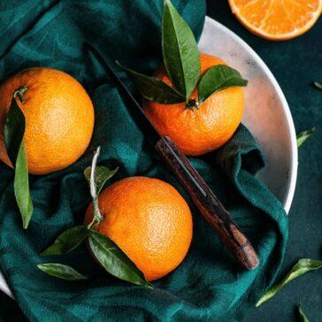 fresh oranges on a green napkin